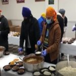 Sikh volunteers prepare over 30,000 meal packets for Americans in self-isolation