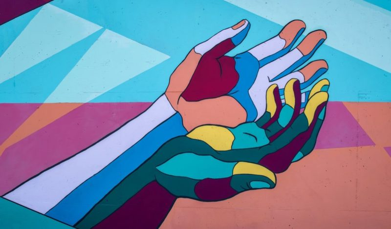 Mural of two hands holding one another