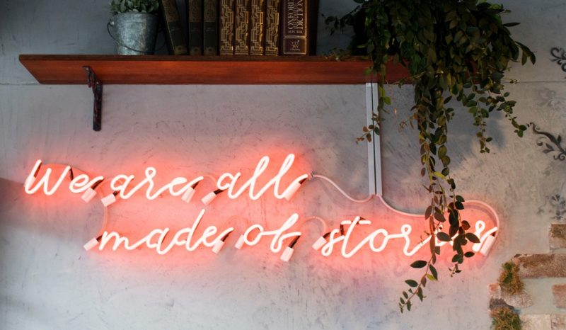"""""""We are all made of stories"""" neon sign"""