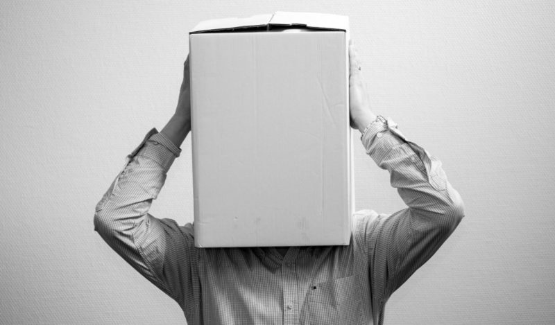 Person with box on head