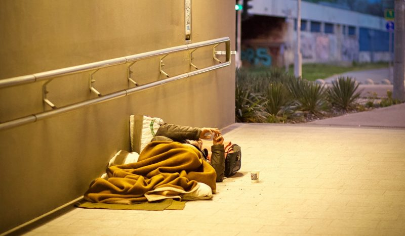 Homeless person lying on the ground